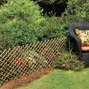 Delightful Classic Willow Installed Vertically Classic Willow Fence In The Garden