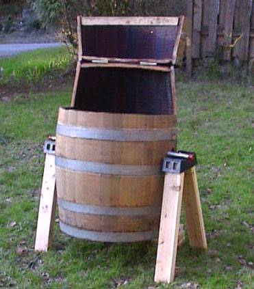 Wine Barrel Tumbling Composter Open In Up Position To Load Materials